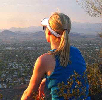 A professional lady reflects on her busy professional life on her after-work hike.